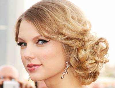 Curly-Hair-Low-Side-Bun-Hairstyle